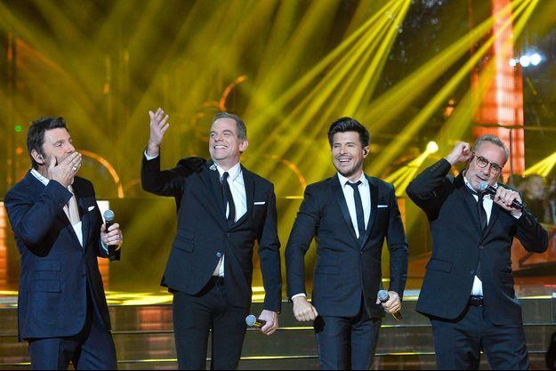 Philippe Lellouche, le chanteur et parrain Garou, le chanteur Vincent Niclo et Antoine Duléry sur le plateau du Téléthon.