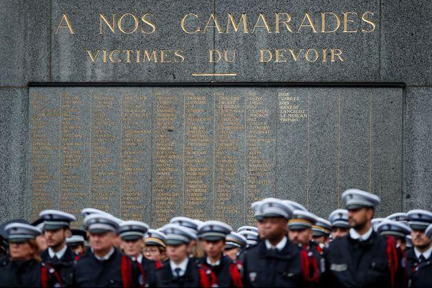 Lors de l'hommage aux victimes de l'attaque de la préfecture de police de Paris, mardi 8 octobre.