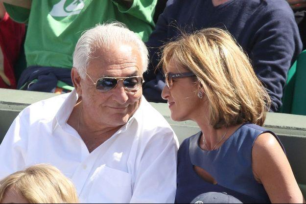 Il peut passer autant de temps qu'il en a envie à Roland-Garros. Dominique Strauss-Kahn et Myriam L'Aouffir, le 30 mai, treize jours avant l'épilogue du procès pour proxénétisme.