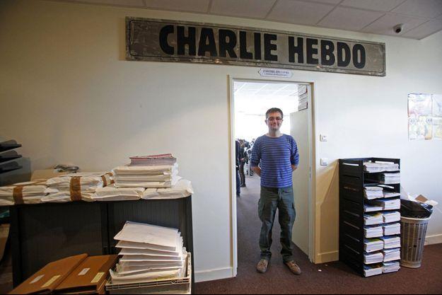 """Charb, dans les locaux de """"Charlie Hebdo"""" en septembre 2012."""