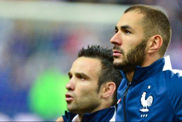 Karim Benzema au côté de Mathieu Valbuena en 2015.