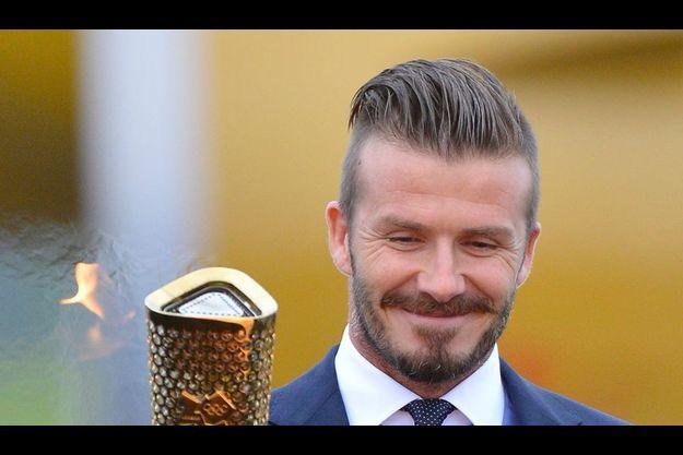 David Beckham et la flamme olympique.