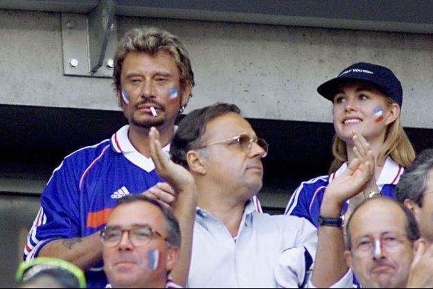 Johnny Hallyday et sa femme Laeticia à la finale de la Coupe du Monde 1998 au Stade de France