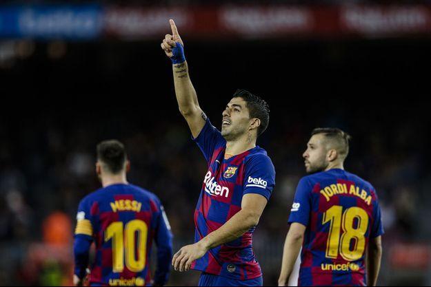 Des footballeurs du FC Barcelone.