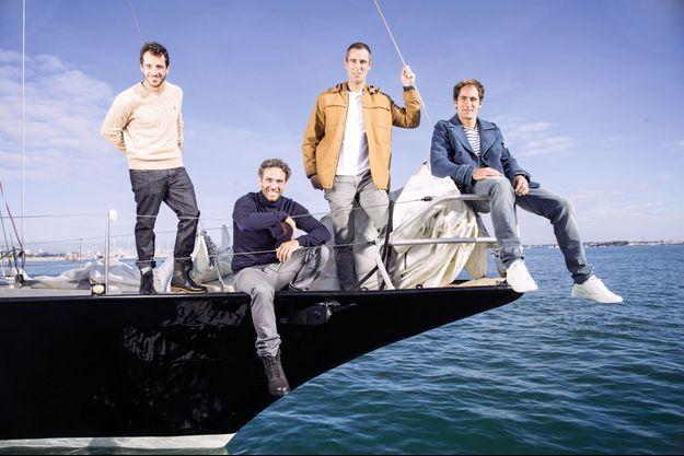 De g. à dr. : Louis Burton, Tanguy de Lamotte, Armel Le Cléac'h et Morgan Lagravière sur le « Pen Duick III » d'Eric Tabarly, à Lorient, le 23 septembre.