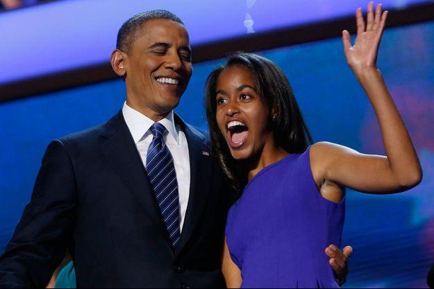 Malia et son père lors de la convention nationale du Parti démocrate au Times Warner Cable Arena de Charlotte, le 6 septembre 2012.