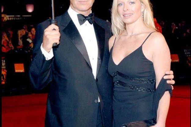 Pierce Brosnan avec Charlotte, en 2006. L'acteur avait adopté la fille de sa première épouse, quand elle avait 15 ans, au décès de son père biologique.
