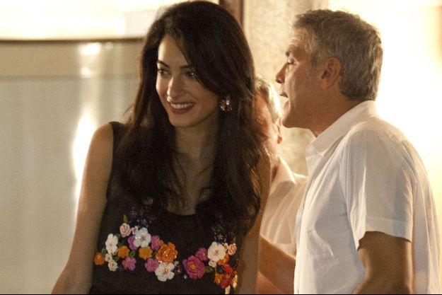 George Clooney et Amal Alamuddin, le 17 juillet 2014, à Cernobbio, en Italie.