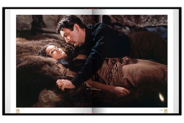 """Photographie du film """"La Dernière chasse"""", de Richard Brooks, 1956, avec Robert Taylor et Debra Paget, extraite du livre """"Encyclopédie du western"""" de Patrick Brion, aux éd. Télémaque."""