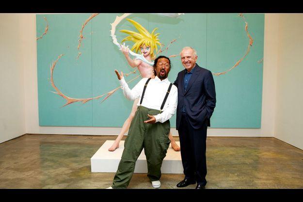L'homme d'affaires et l'artiste japonais Takashi Murakami devant le tableau « Cream » (1998) et la sculpture « My Lonesome Cowboy », (1998)