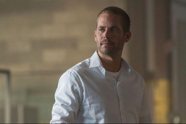 """Dans """"Fast & Furious 7"""", le personnage de Paul Walker tire sa révérence. Une sortie qui fait tristement écho à la disparition de l'acteur, mort en novembre 2013."""