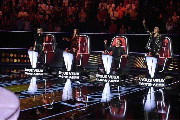 """Lara Fabien, Amel Bent, Marc Lavoine et Pascal Obispo sur le plateau de la saison 9 """"The Voice""""."""