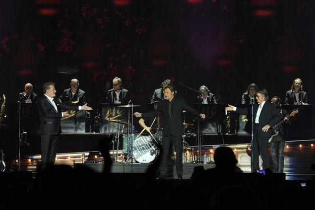 Eddy Mitchell, Johnny Hallyday et Jacques Dutronc sur la scène de Bercy.