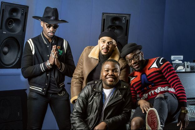 A g., Jo-A, Raphaël Nyadjiko (bonnet), Julio et Christopher Ghenda posent dans les Studios de la Seine à Paris, le 12 février.