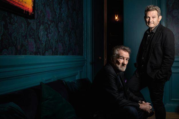 Le chanteur avec son fils, Eddy.
