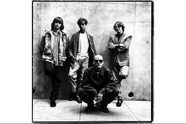 De g. à dr. : Peter Buck, Bill Berry, Michael Stipe et Mike Mills, en 1994.