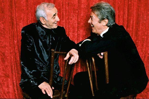 Charles Aznavour et Alain Delon en décembre 1997.