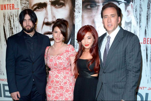 Weston Cage sa compagne Danielle, Nicolas Cage et sa femme Alice Kim à Londres en 2013.