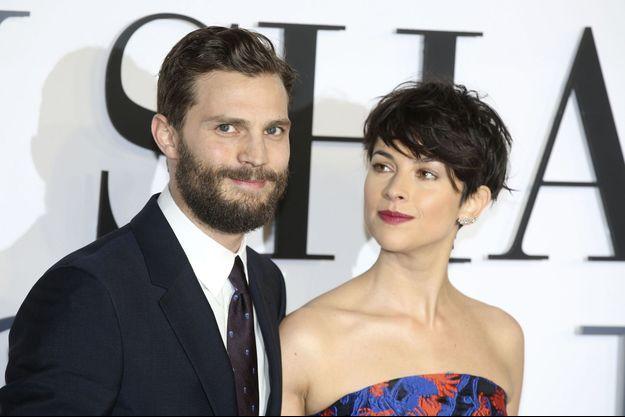 """Jamie Dornan et Amelia Warner à l'avant-première du film """"50 Nuances de Grey"""" à Londres le 12 février dernier"""