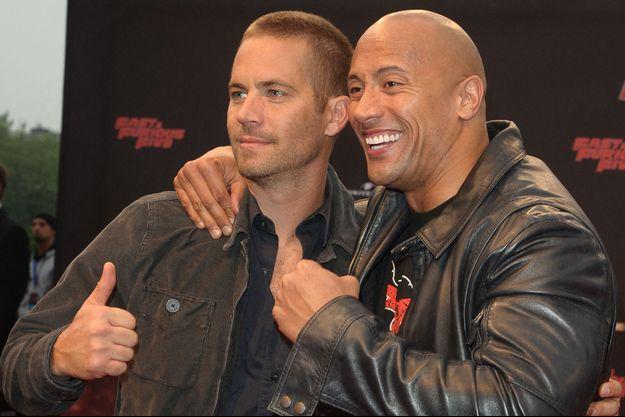 """Paul Walker et Dwayne Johnson en 2011 lors de la première de """"Fast & Furious 5"""""""