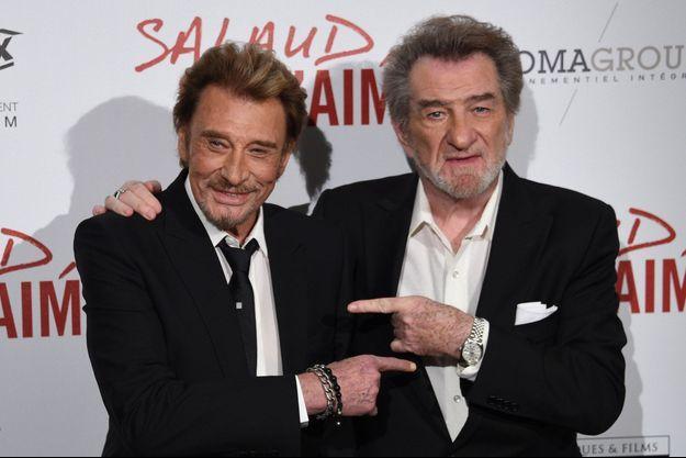 Johnny Hallyday et Eddy Mitchell, le 31 mars 2014 à Paris.