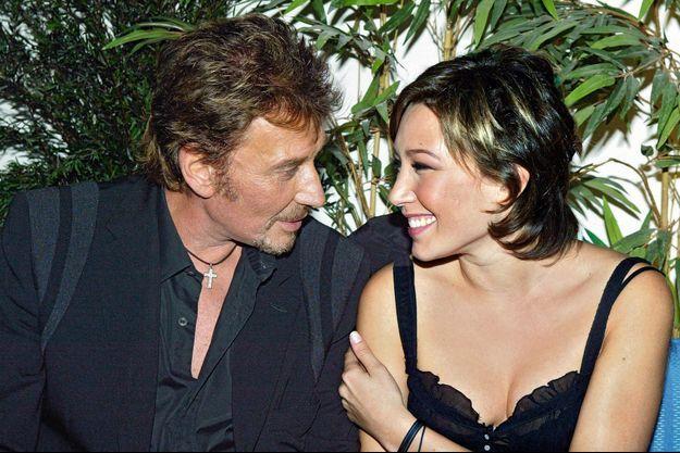 Père et fille à l'inauguration de l'Amnesia, le 1er octobre 2003 à Paris.