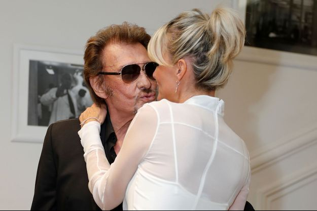 Johnny et Laeticia Hallyday au défilé Dior de la Fashion Week à Paris, 2016
