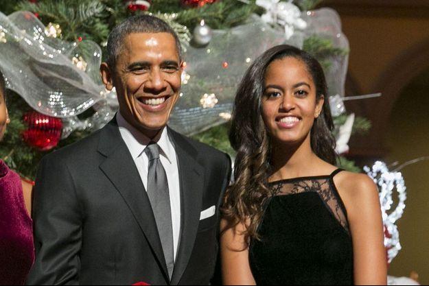 Barack Obama et sa fille aînée, Malia, le 14 décembre dernier à Washington.