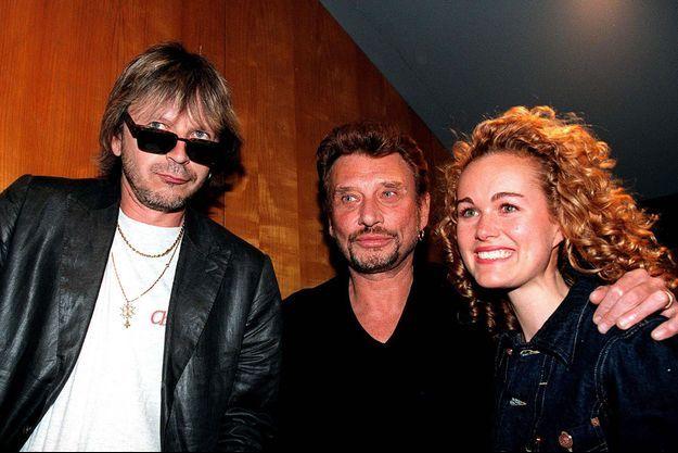 Renaud, ici avec Johnny et Laeticia Hallyday en 1998.