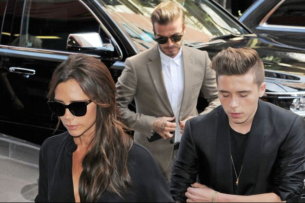 Victoria, David et Brooklyn Beckham à New York le 13 septembre 2015.