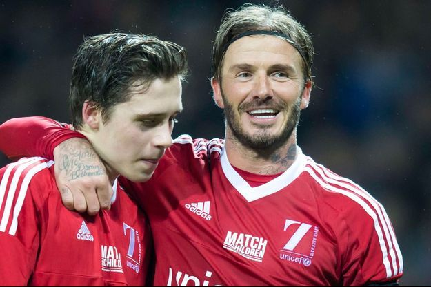 Père et fils lors d'un match pour l'UNICEF en novembre dernier à Manchester.