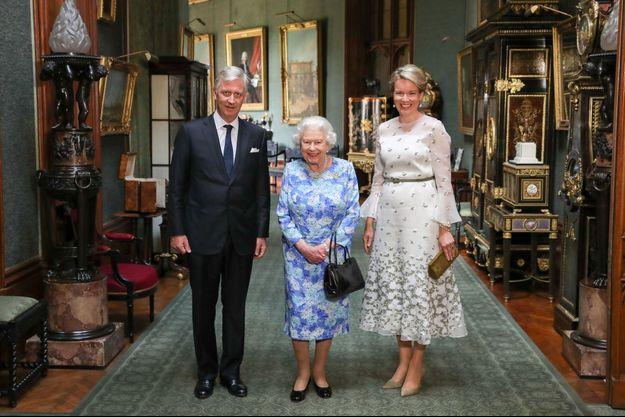 La reine Mathilde de Belgique et le roi des Belges Philippe avec la reine Elizabeth II au château de Windsor le 14 juillet 2018