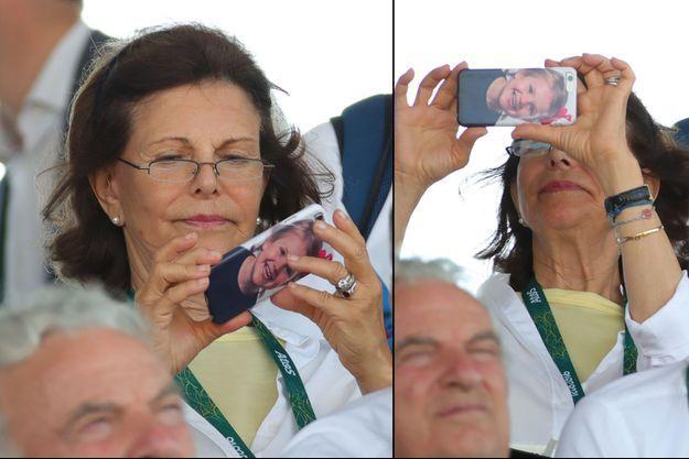 """La reine Silvia de Suède et son téléphone """"princesse Estelle"""" aux JO de Rio, le 19 août 2016"""