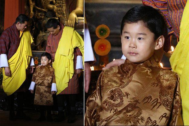 Le prince Jigme Namgyel avec son père le roi du Bhoutan Jigme Khesar Namgyel Wangchuck et son grand-père l'ex-roi Jigme Singye Wangchuck, le 5 février 2020 jour de ses 4 ans, lors d'une cérémonie à Thimphu