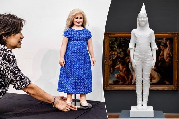 """Poupée princesse Catharina-Amalia des Pays-Bas par Elena Timkaeva. A droite, """"My Future Queen"""" de Jan Fabre figurant la princesse Elisabeth de Belgique"""