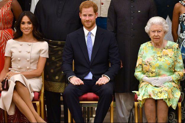 Meghan Markle, le prince Harry et la reine Elizabeth II, le 27 juin dernier, à Londres.