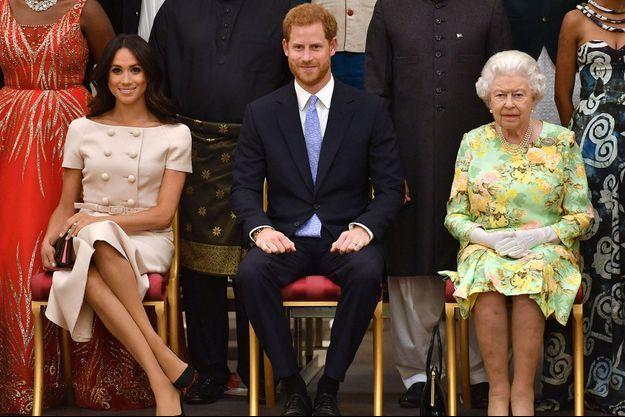 Meghan, Harry et Elizabeth II au Palais de Buckingham en juin 2018