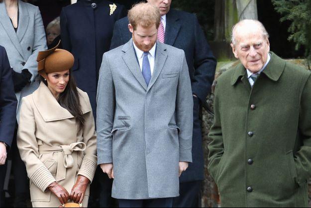 Meghan Markle, le prince Harry et le prince Philip lors des célébrations de Noël en décembre 2017