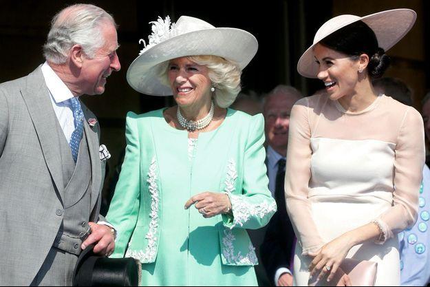 Meghan Markle déjà complice avec le prince Charles et Camilla.