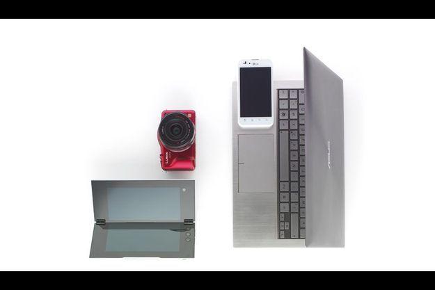 Plus simple qu'un appareil Reflex : le compact hybride doté d'un objectif interchangeable (Panasonic Lumix GF3). Ludique et différente, la tablette pliante Sony P. Plus puissant qu'un netbook, voici l'ultra book (Asus UX21). Dessus, le smartphone LG, optimus white ultraléger.