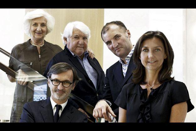Michèle et Philippe Cassegrain avec leurs enfants, Olivier, Jean et Sophie.
