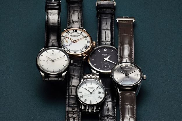 1. Heritage Ultra Thin en acier, bracelet en alligator, mouvement automatique. Zenith. 4 100 €. 2. L.U.C 1963 en or rose, bracelet en alligator, mouvement à remontage manuel. Série limitée à 50 exemplaires. Chopard. 29 010 €. 3. Elegant en acier, mouvement automatique. Longines. 1 160 €. 4. T-Complication Chronometer en acier, bracelet en alligator, mouvement à remontage manuel. Tissot. 1 335 €. 5. Carrera en acier, bracelet en alligator, mouvement automatique. TAG Heuer. 2 200 €.