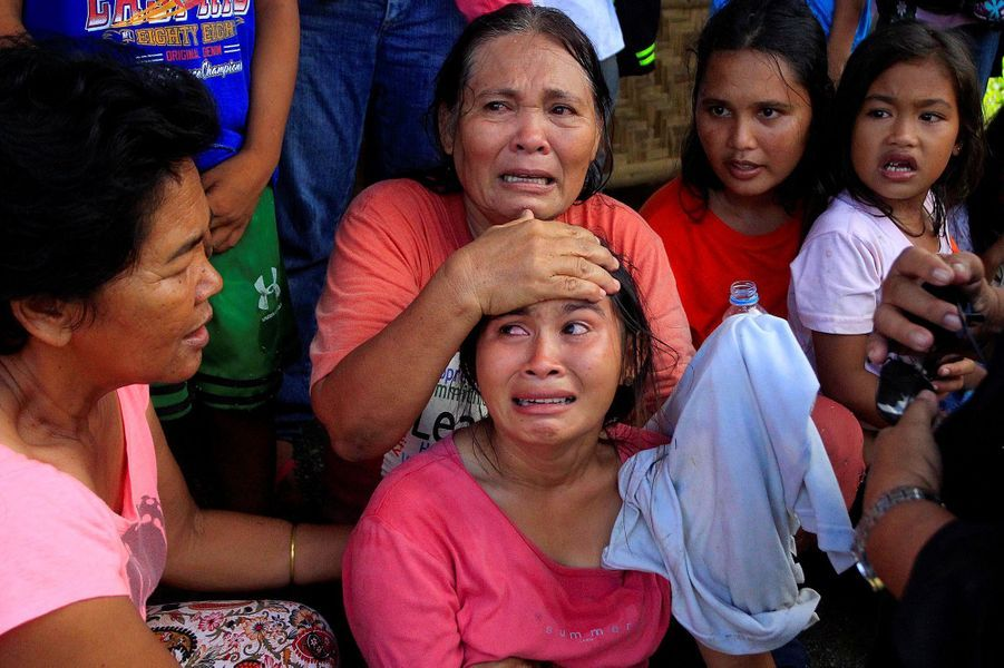 Des Philippins évacués àPigcawayan, aux Philippines, le 21 juin 2017.
