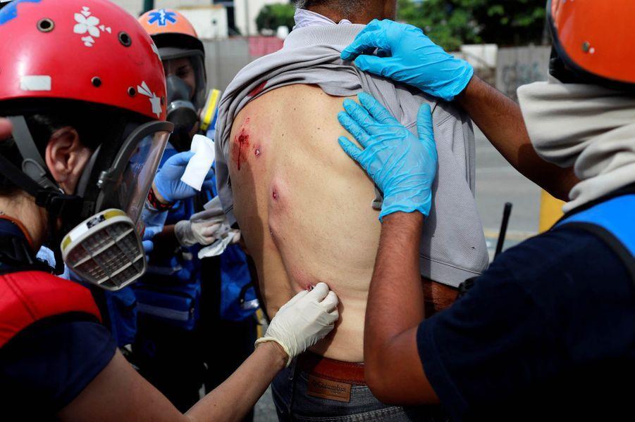 Photo prise lors des manifestations à Caracas le 27 juillet 2017.