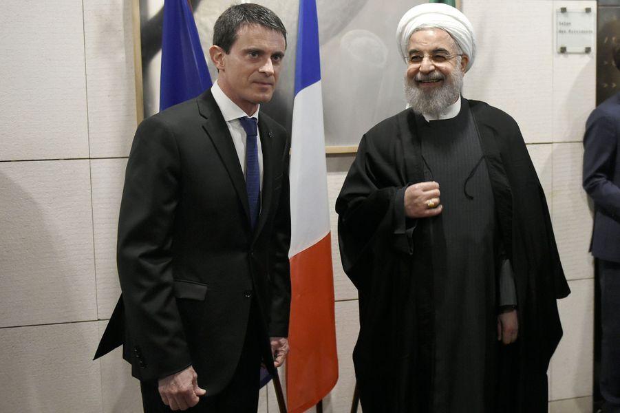 Visite officielle du président iranien Hassan Rohani en France, ici au siège du Medef avec Manuel Valls