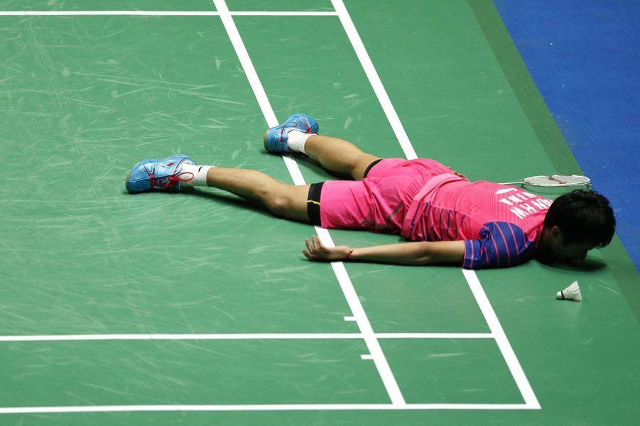 Le Chinois Tian Houwei lors des quarts de finale duYonex All England Open Badminton.