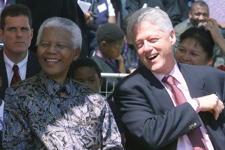 Avec Bill Clinton, en septembre 2002