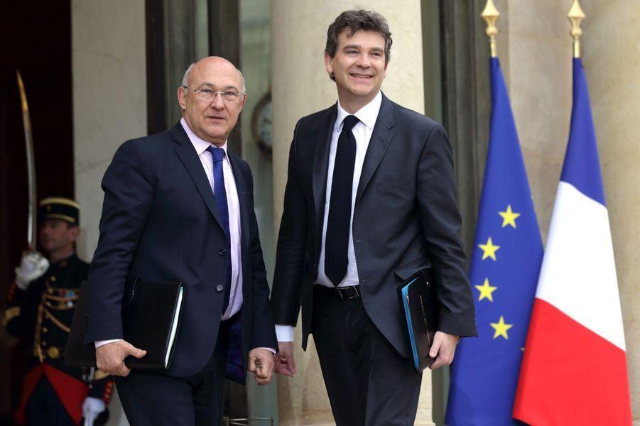 Michel Sapin, ministre des Finances, et Arnaud Montebourg, ministre de l'Economie, du Redressement productif et du numérique
