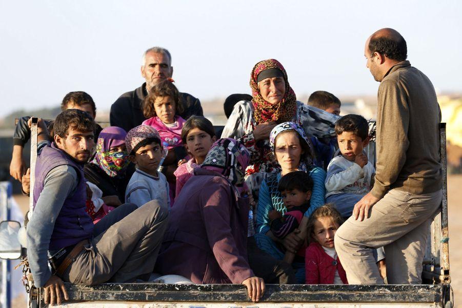Les Kurdes fuient Kobané face à l'avancée de Daesh
