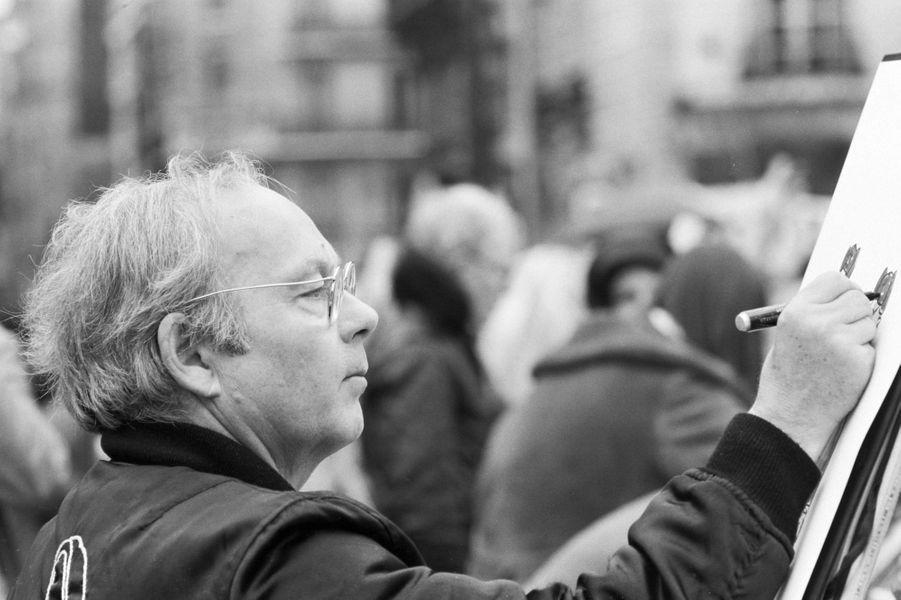 Siné manifestant devant l'ambassade d'URSS à Paris en soutien a Syssoiev, en 1984.